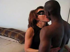 Horny masked MILF loves fucking with a kinky black dude