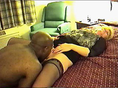 Mature blonde woman fucks with a well hung black stud