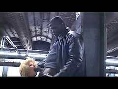 Blonde mature slut blows a black cock at the subway