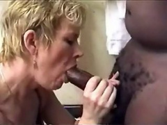 Cock hungry milf eats one tasty black sausage and its juice