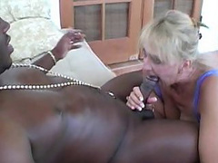 Busty blonde nanny titty-fucking a massive black snake