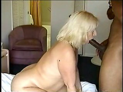 Blonde Milf with a chubby body sucking a BBC in a hotel room