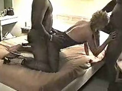 Short haired blonde Milf tugging on a black cock in a threesome