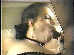 Milf in a full body stocking sucking of two cocks and drilled
