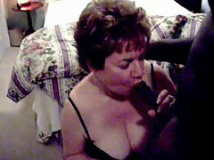 Mature nanny on her knees blowing a massive black cock