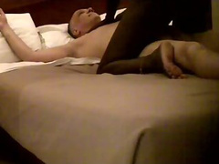 Mature hunk in bed with his black lover getting a massage and a BJ