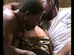 Curly haired bitch fills her mouth with two black dicks