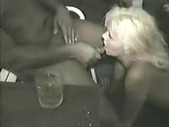 Good looking blonde Milf munching on big black cocks