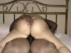 This man inserts his covered chocolate cock into her amazing pussy