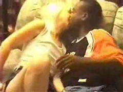 Tipsy blonde making out with a black dude in her family's living room